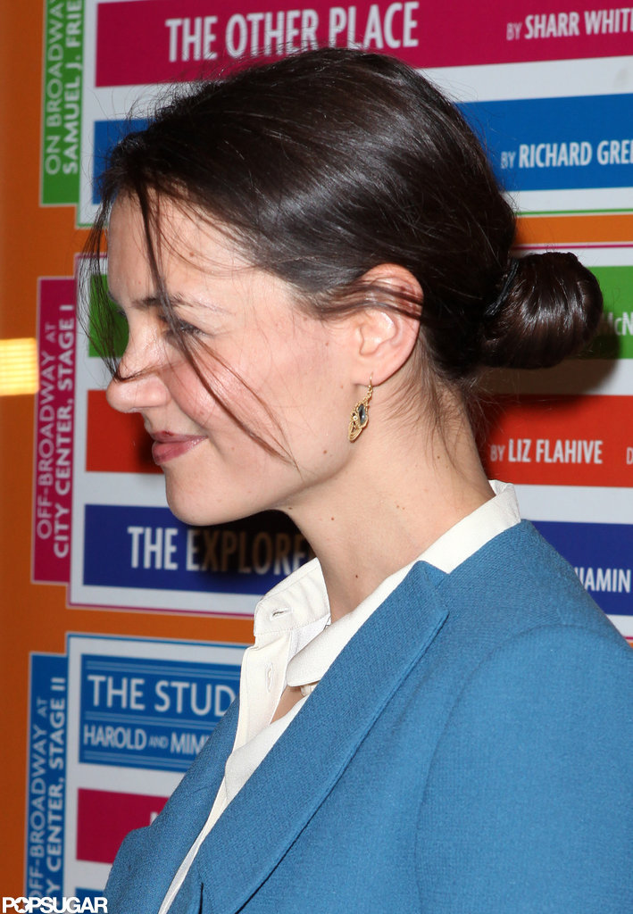 Katie Holmes wore her hair back in a bun.