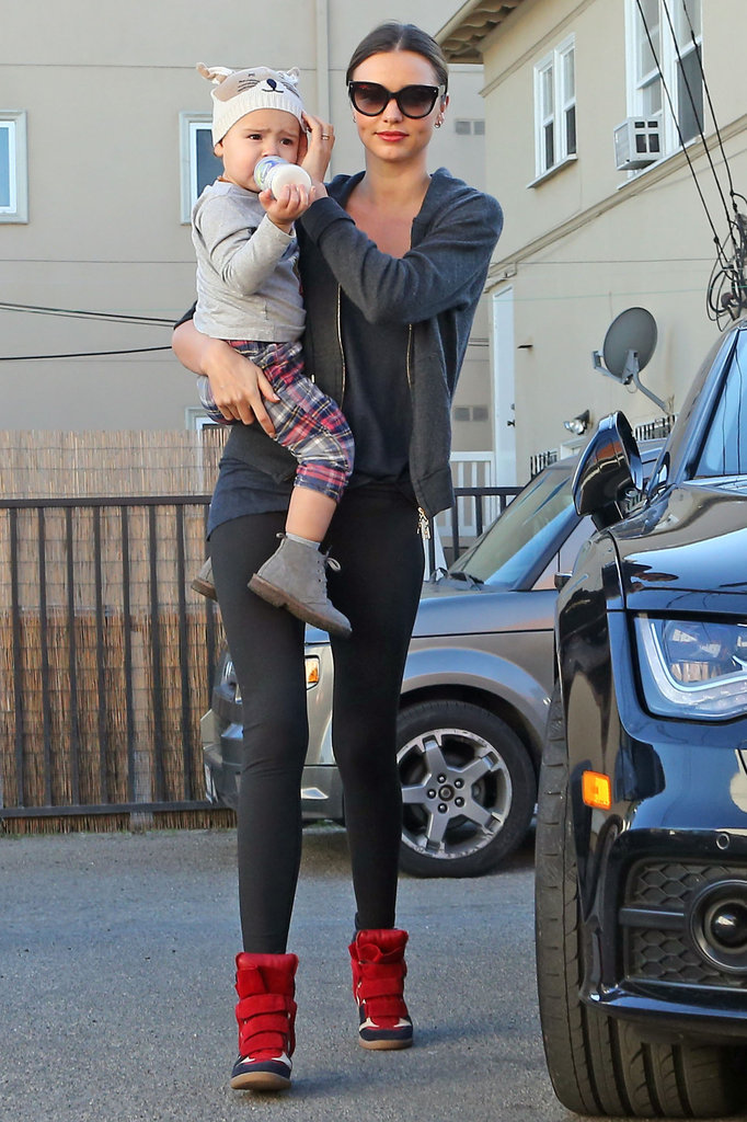 Miranda Kerr wore red high-tops as she hung out with Flynn Bloom.