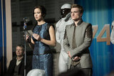Jennifer Lawrence as Katniss and Josh Hutcherson as Peeta in Catching Fire.