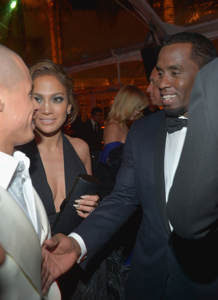 Jennifer Lopez smiled mid conversation as she was sandwiched between current beau Casper Smart and ex P Diddy.