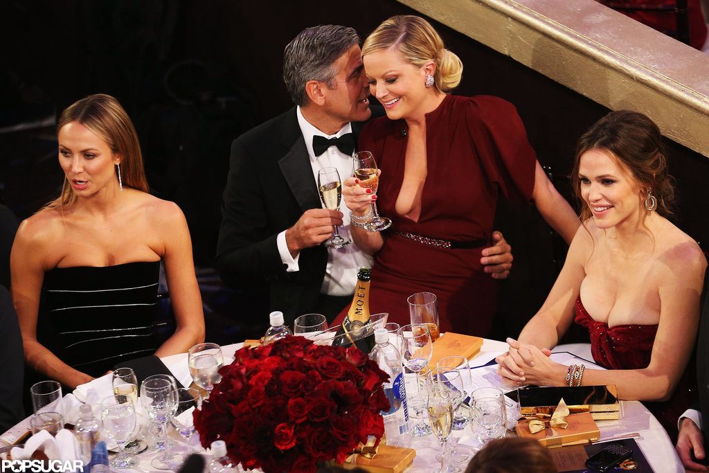 Amy Poehler sat on George Clooney's lap during the show.