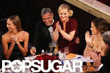 Amy Poehler sat on George Clooney's lap while hosting the Golden Globes.