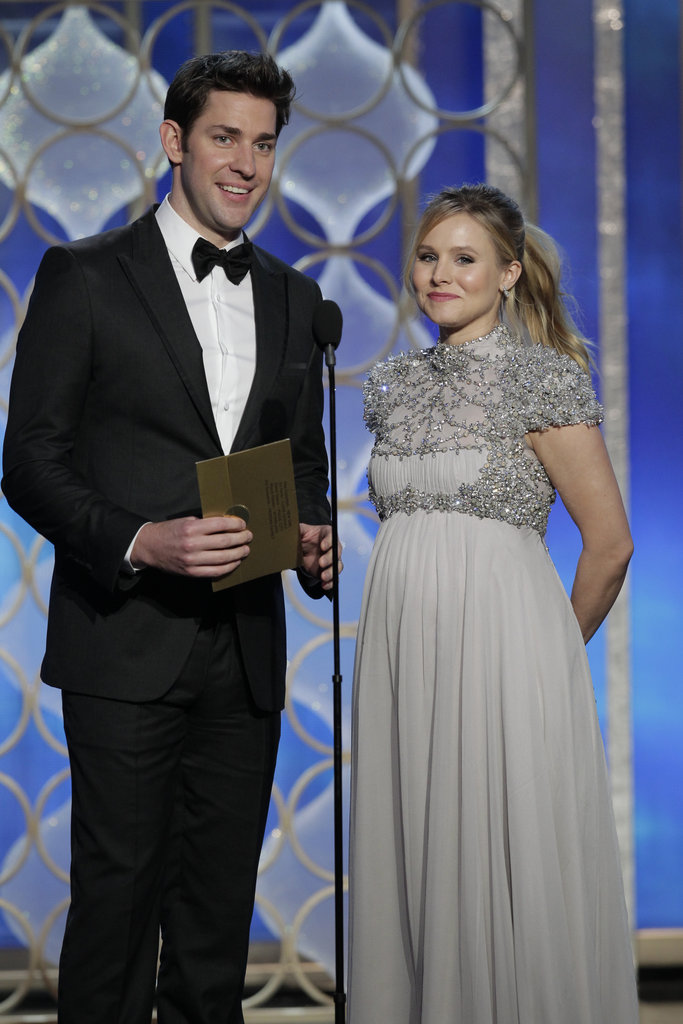 A very pregnant Kristen Bell presented alongside John Krasinski.