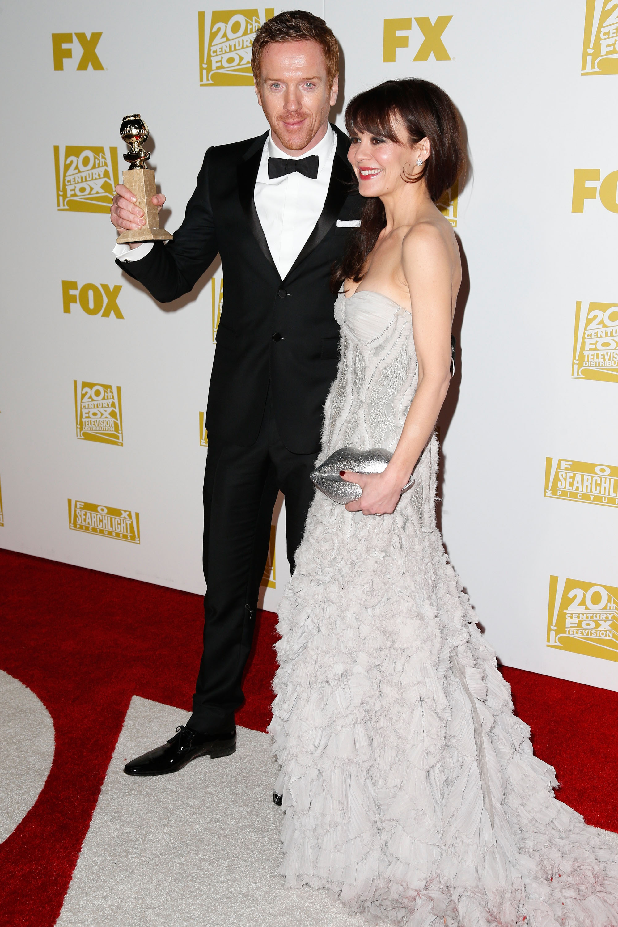 Damian Lewis and Helen McCory posed together with his Golden Globe.
