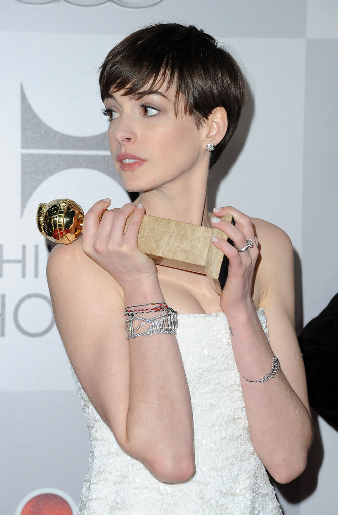 Anne Hathaway held up her award.