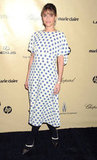 Amanda Peet opted for a printed blue and white shift dress, complete with black tights and pointy-toe pumps, at the Weinstein party.