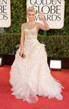 Gold beading adding a glamorous touch to Julianne Hough's princess-worthy Monique Lhuillier gown.