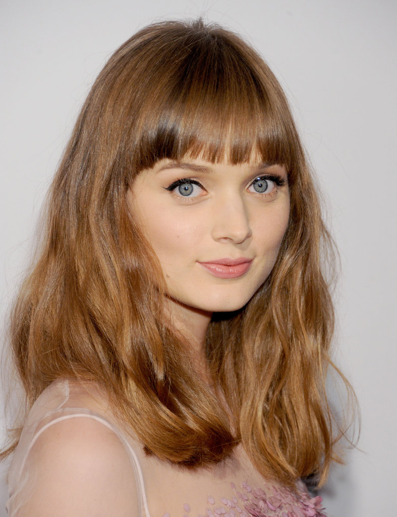 You don't have to have bangs like Bella Heathcote to pull off this effortless look. Simply run a brush through your natural texture. You can also rough it up a little with a dry shampoo for volume — and even add clip-in fringe if need be.