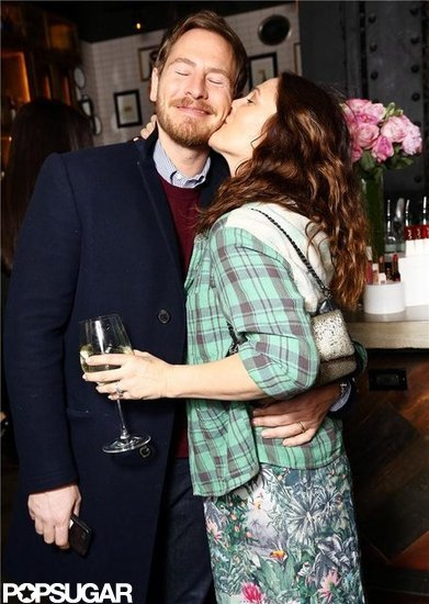 Actress Drew Barrymore kissed Will Kopelman at the launch party for her cosmetics brand Flower Beauty.