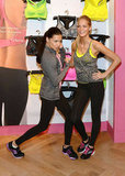 Adriana Lima and Erin Heatherton had fun posing at the Victoria's Secret launch of the VSX collection in NYC.