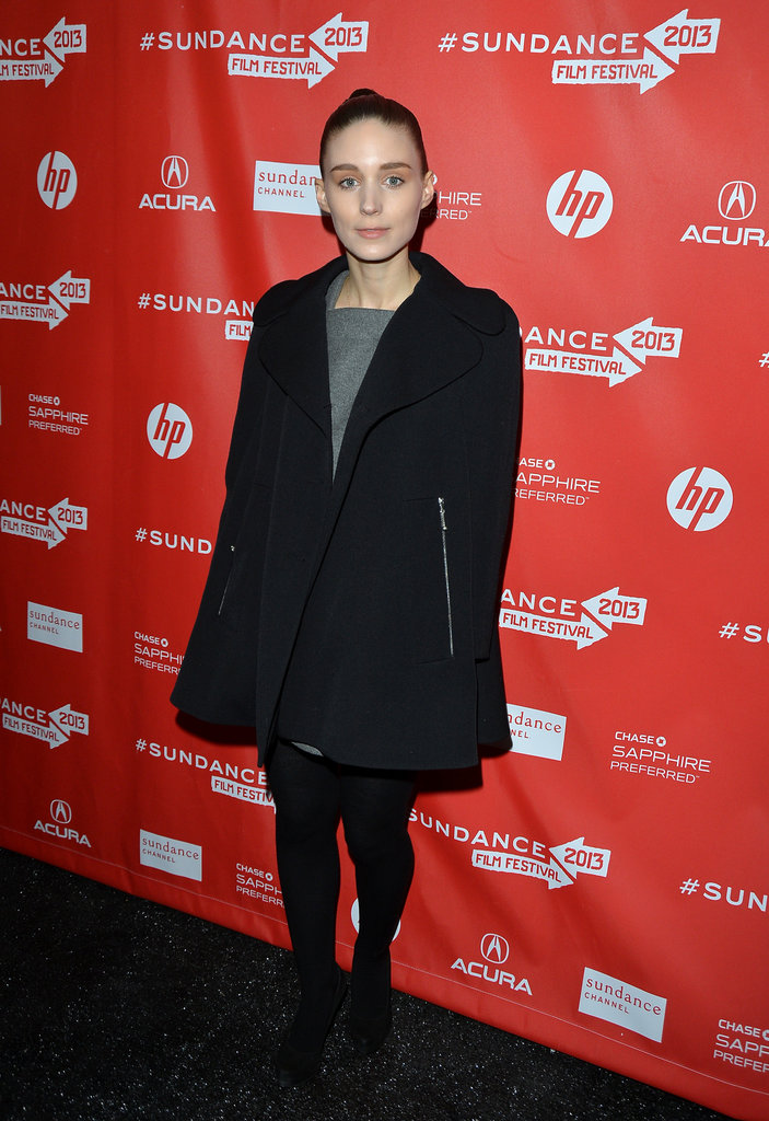 Rooney Mara kept it chic at the Emanuel and the Truth About Fishes premiere wearing a gray dress, black cape coat, and booties.
