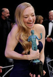 Amanda Seyfried had fun with a statue.