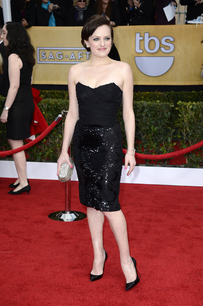 Elisabeth Moss opted to go short in a black strapless sequined Dolce & Gabbana dress.