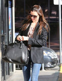 Miranda Kerr toted her black Givenchy bag.