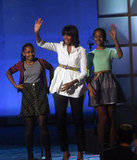Michelle Obama waved and smiled with her girls Malia and Sasha at the Kids' Inaugural concert, which she called her favorite moment of the weekend.