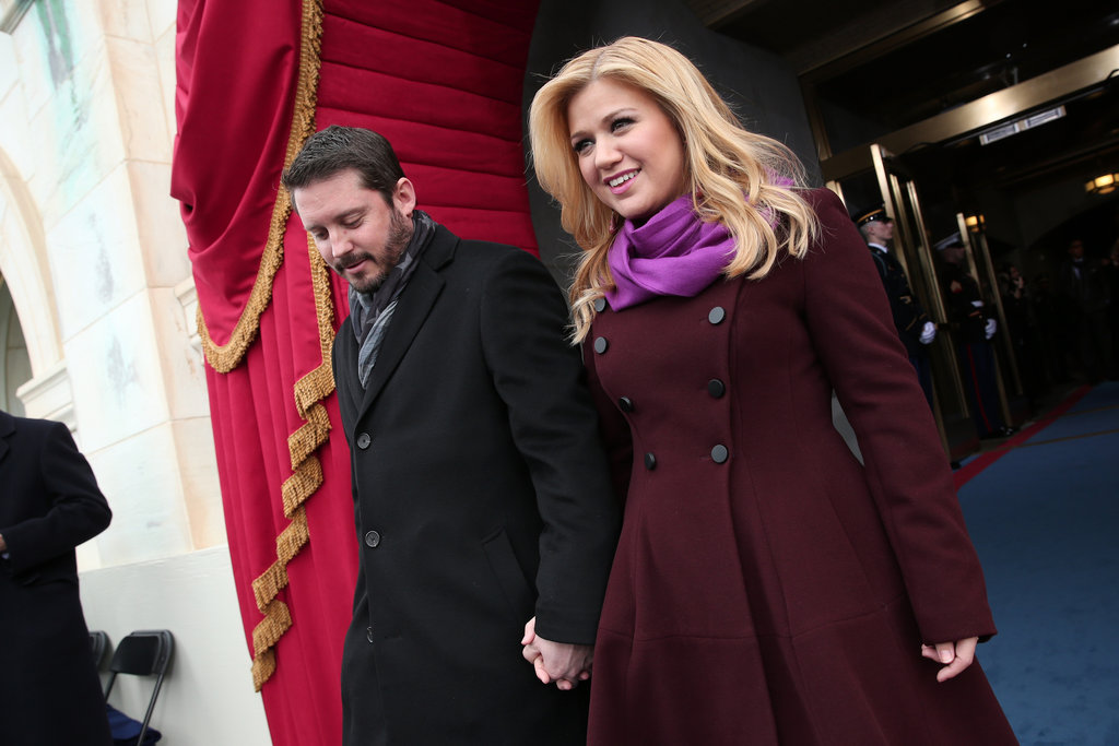 Kelly Clarkson, who also sang in the morning's swearing-in ceremony, offset a burgundy coat with a lighter fuchsia scarf.
