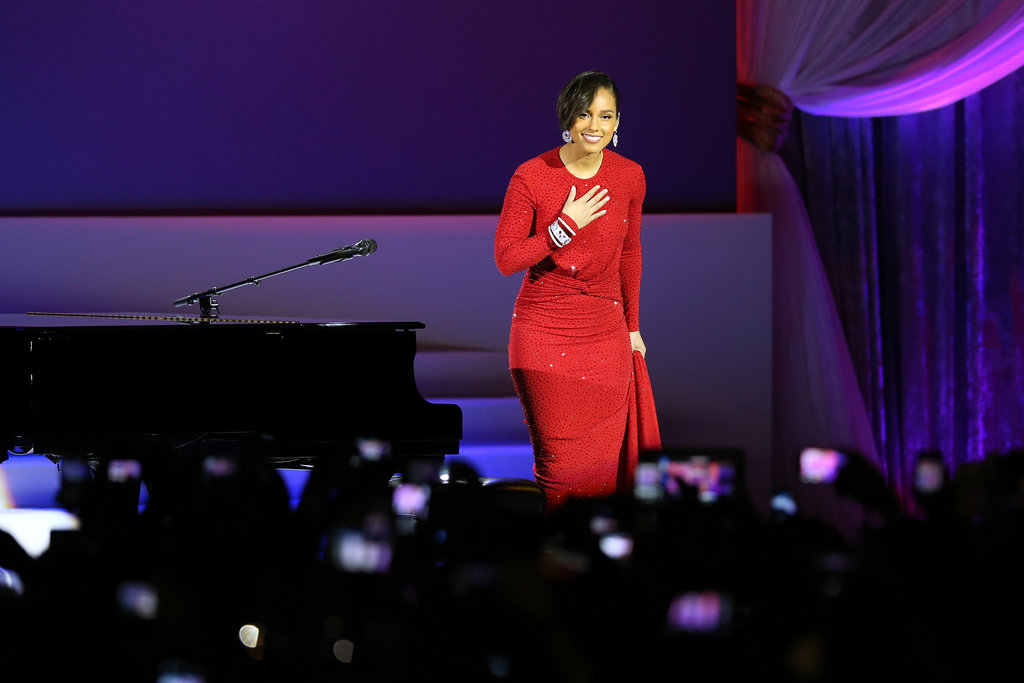 Alicia Keys gave a stunning performance at the public inaugural ball at the Walter E. Washington convention center wearing a form-fitting red beaded dress by Michael Kors.