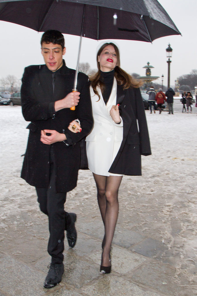 Laetitia Casta chose a black and white colour scheme — perfection for Paris. Her netted veil and bold red lips added major glamour to her two-tone style.