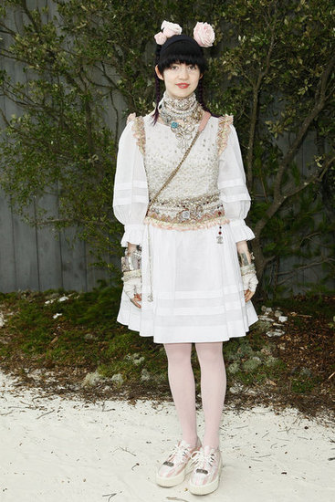Grimes got decked out in Chanel while attending the Chanel Haute Couture fashion show at the Grand Palais in Paris.