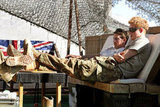 Prince Harry relaxed with a friend in Afghanistan in September.