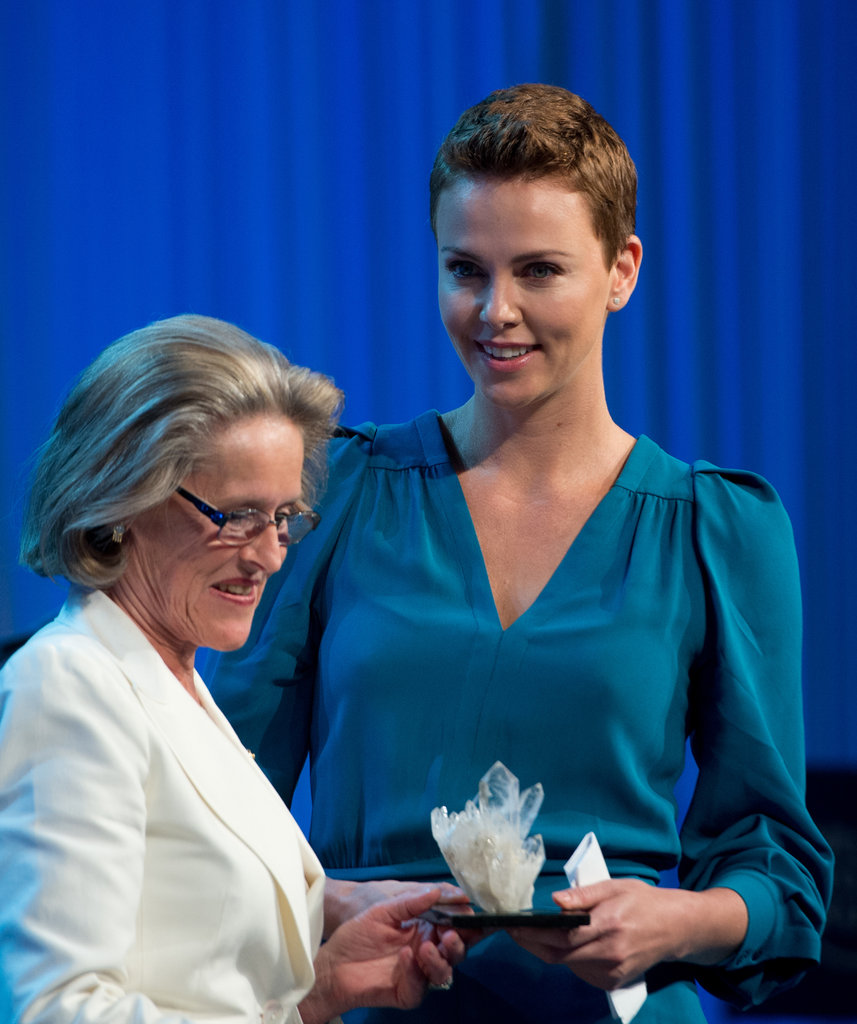 Charlize Theron accepted the award on stage.