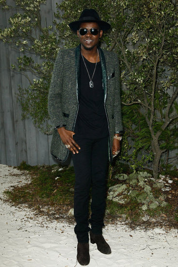 Theophilus London posed for photos at the Chanel Haute Couture fashion show on Tuesday.