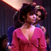 For her first time at the club (with a fake ID, obviously), Kelly tries to look as mature as possible. She opts for a fuchsia tie-front top, drop earrings, and a messy chignon. She looks beautiful, even when she spots her boss/boyfriend dancing with another girl.