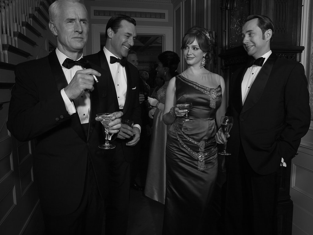 John Slattery, Jon Hamm, Christina Hendricks, and Vincent Kartheiser on Mad Men.