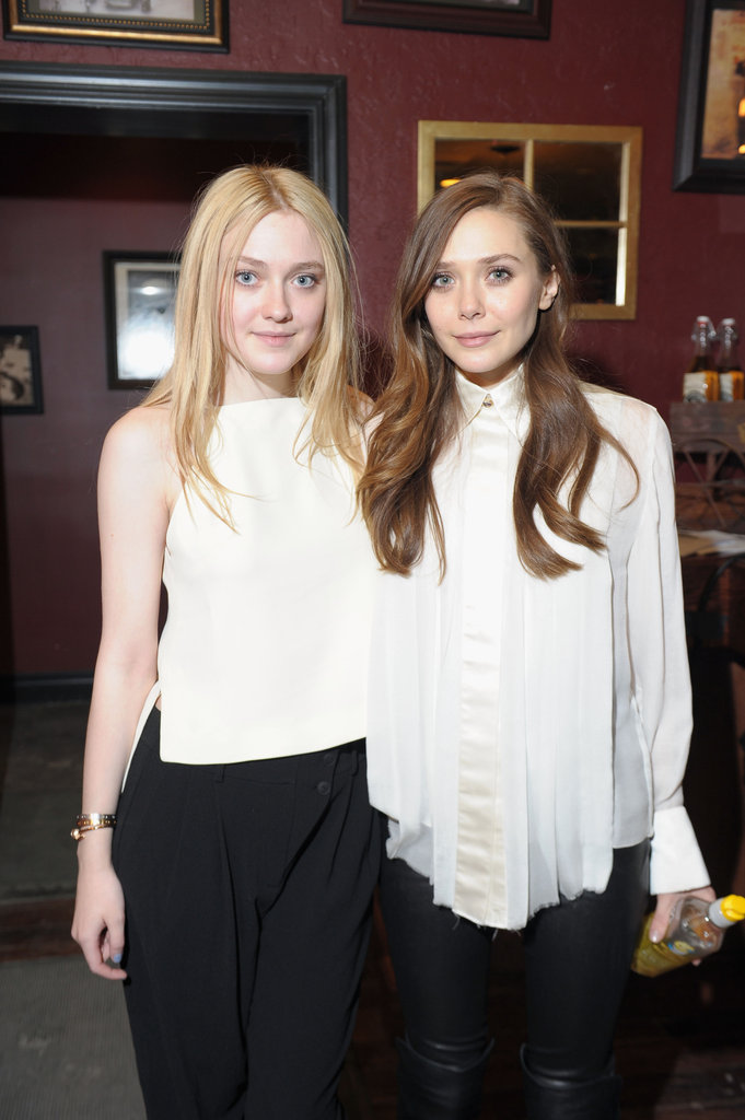 Costars Dakota Fanning and Elizabeth Olsen posed for pictures during a cast-and-crew lunch at Sundance on Wednesday. The two play onscreen best friends in Naomi Foner's Very Good Girls.