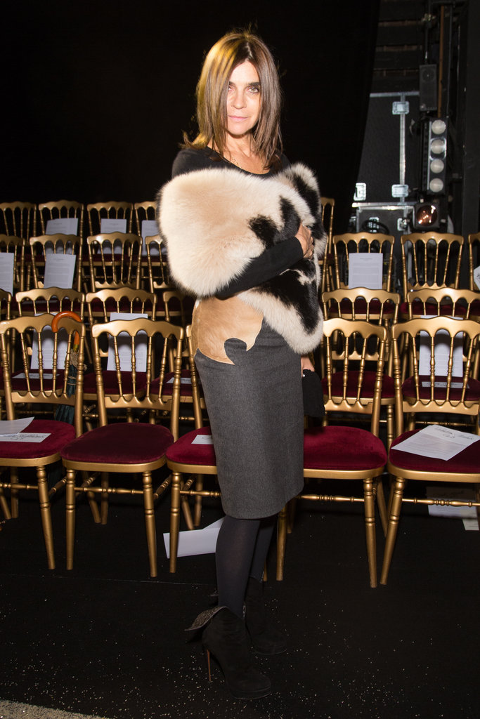 Carine Roitfeld exuded sexy glamour at the Ulyana Sergeenko show in a fur shrug and a grey pencil skirt.