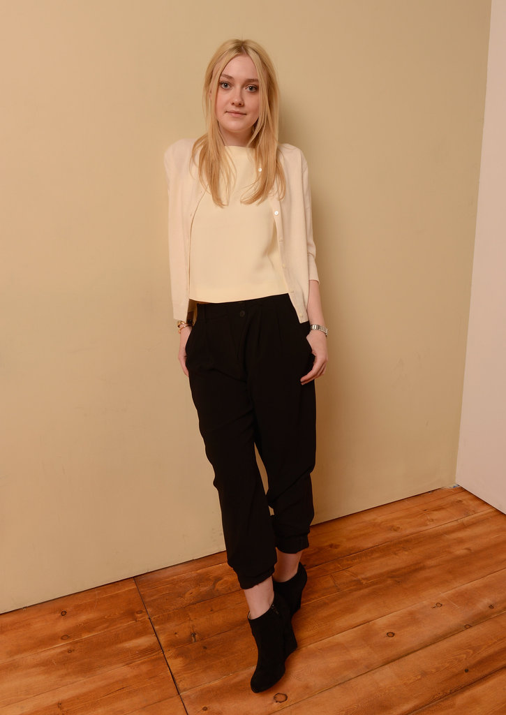 Dakota Fanning played with proportions in a cropped eggshell top, slouchy black trousers, and a preppy cardigan.