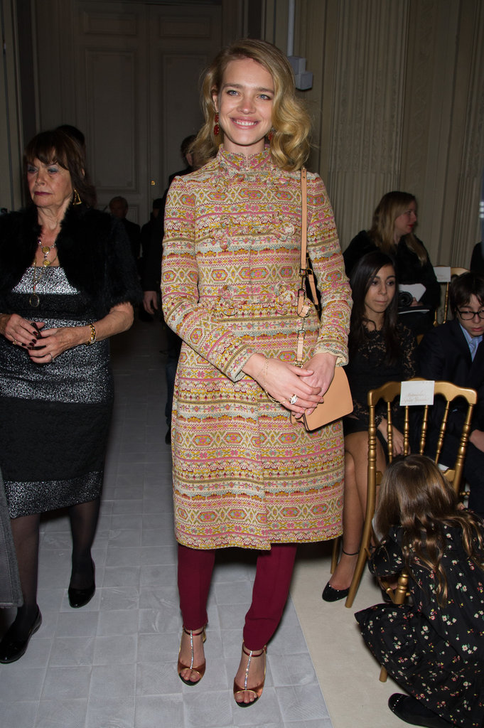 Natalia Vodianova smiled for the cameras in a printed coat and wine-coloured trousers at Valentino.