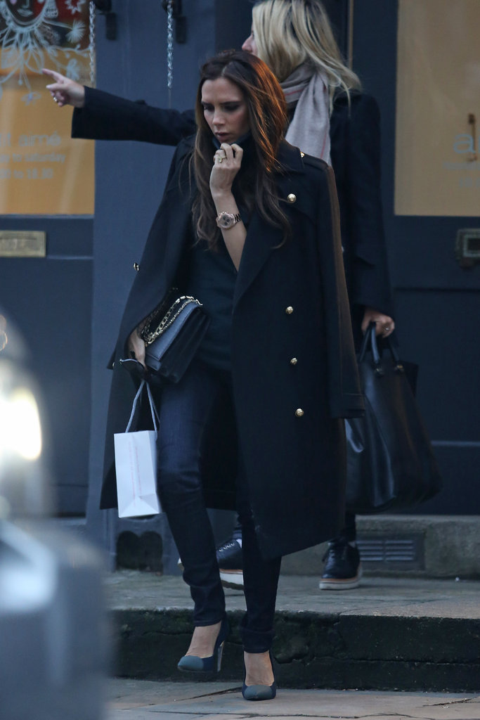 Victoria Beckham tried to keep warm while shopping in Notting Hill on Thursday.