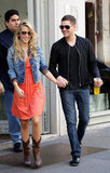 Lusiana Lopilato and Michael Bublé held hands while out in Milan in May 2010.