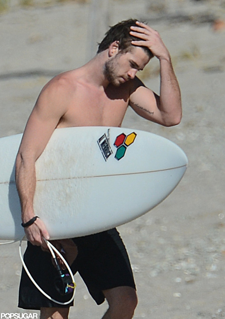 Liam Hemsworth showed off an arm tattoo shirtless.