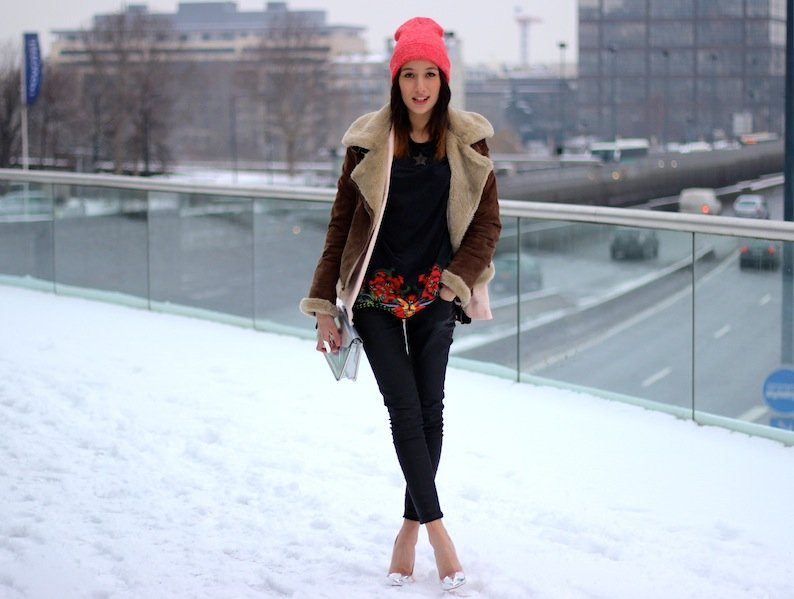 A cozy shearling topper warms up a sleek pair of heels and a bright print. Source: Lookbook.nu