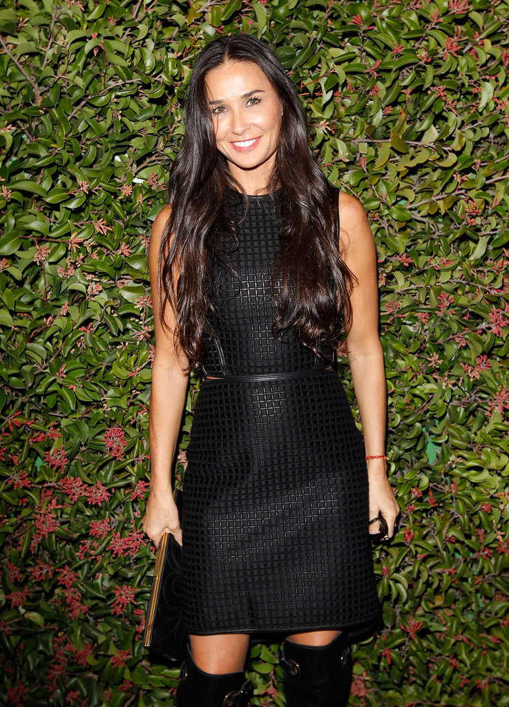 Demi Moore sported knee-high black leather boots.