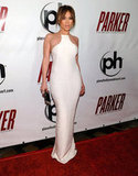 Jennifer Lopez attended the Parker premiere in Las Vegas wearing a formfitting white gown with sheer detailing from KaufmanFranco. While most of us can't pull off a white gown quite as tight as this one, swap out your usual little black dress for a stunning white rendition for your next fancy affair.