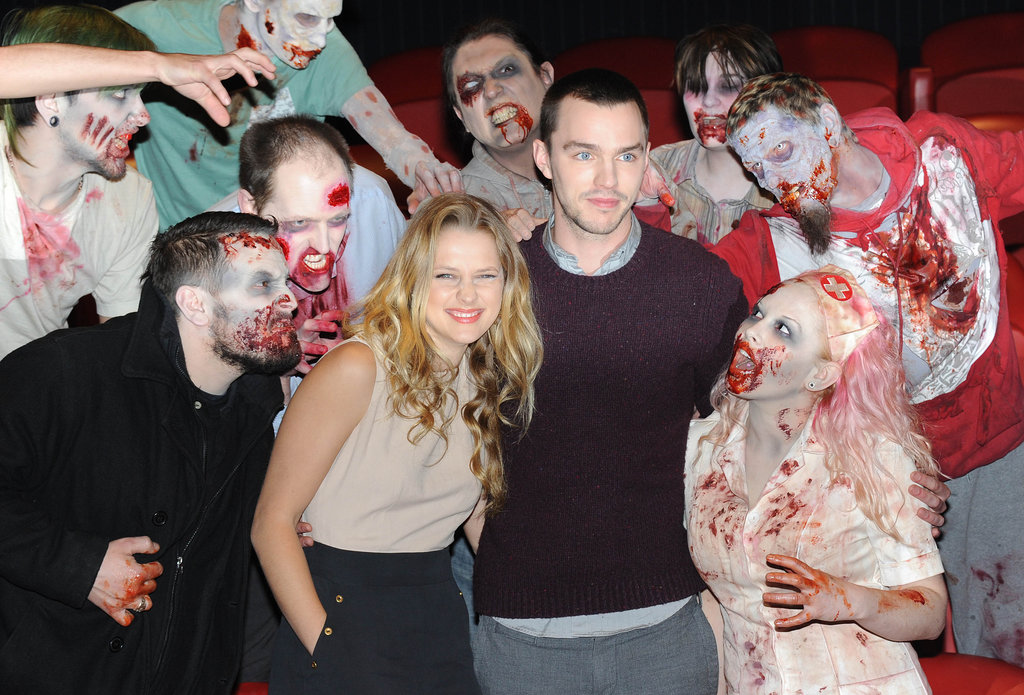Teresa Palmer and Nicholas Hoult attended the photo call for their new zombie flick Warm Bodies in London on Jan. 18 — complete with zombies!