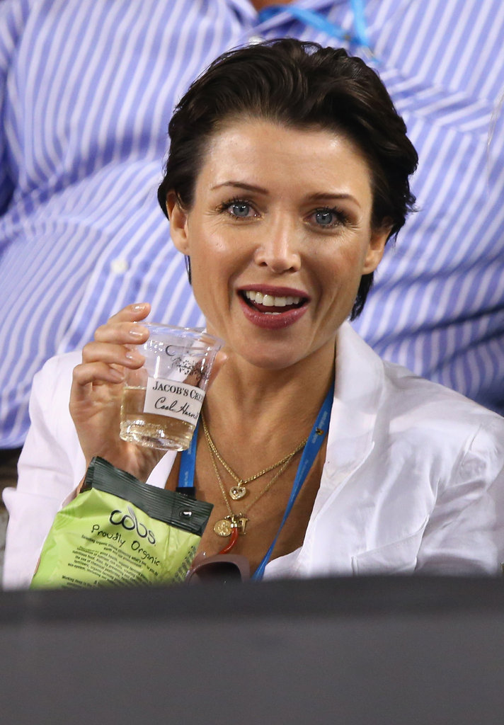 Dannii Minogue watched the fourth round mens' match between Roger Federer and Milos Raonic at the Australian Open in Melbourne on Jan. 21.