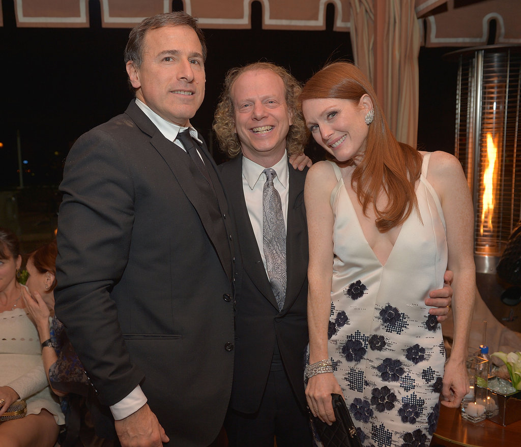 Director David O. Russell and producer Bruce Cohen posed with Julianne Moore at the Weinstein Company SAGs party.
