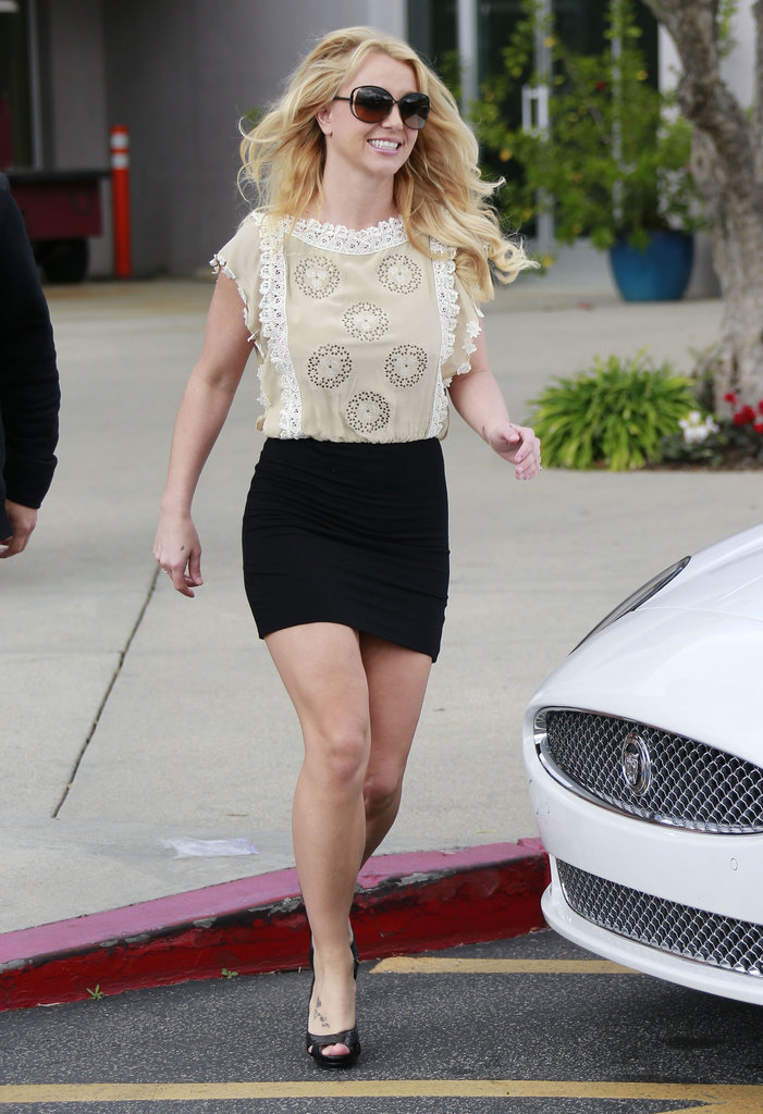 Britney Spears wore a white blouse and a black skirt.