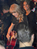 Taylor Swift played her guitar for the crowd.