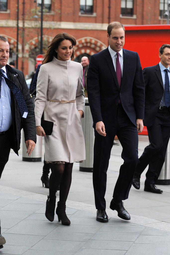 Kate Middleton made an official visit to Cambridge wearing a soft-gray Valentino coat with black tights, black ankle boots, and a matching clutch.
