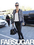 Miranda hit the airport in a pair of leather skinnies, a leopard-print A.L.C. sweater, and her beloved Isabel Marant wedge sneakers.