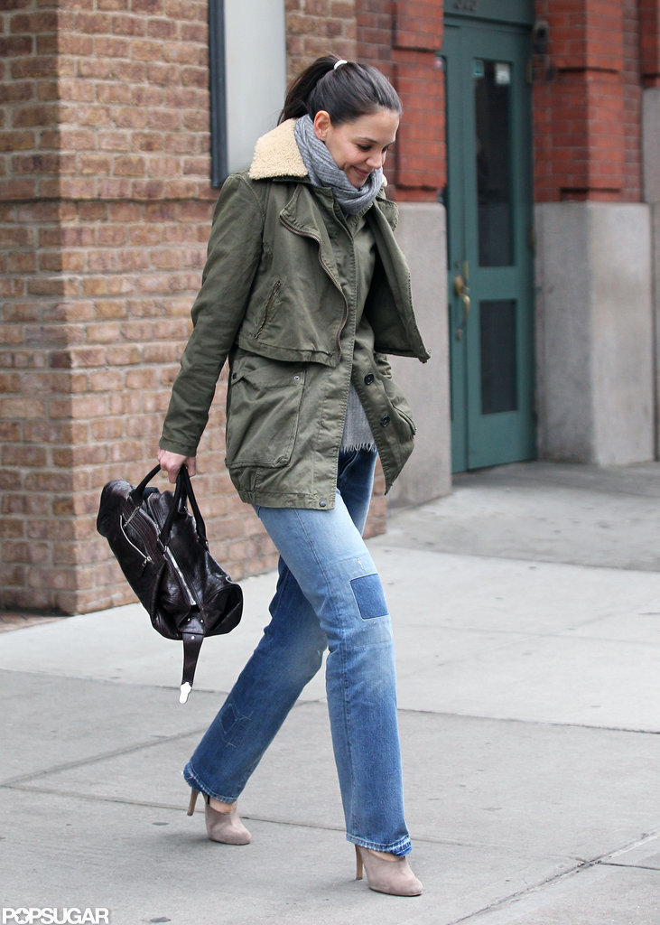 Katie Holmes wore patchwork jeans and a green jacket.