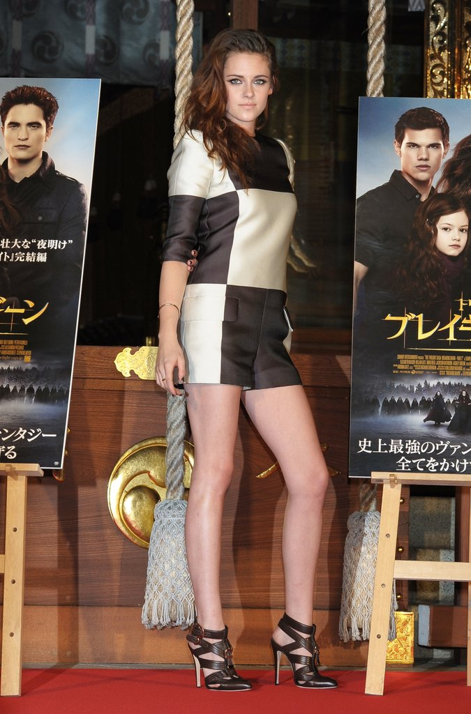 Kristen Stewart showed off her pins in Louis Vuitton's checkered romper at a The Twilight Saga: Breaking Dawn Part 2 press event in Tokyo.