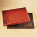 Serve up cocktails on these Chinese-inspired wooden trays ($48).