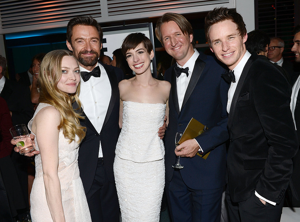 Amanda Seyfried, Hugh Jackman, Anne Hathaway, and Eddie Redmayne posed with director Tom Hooper.