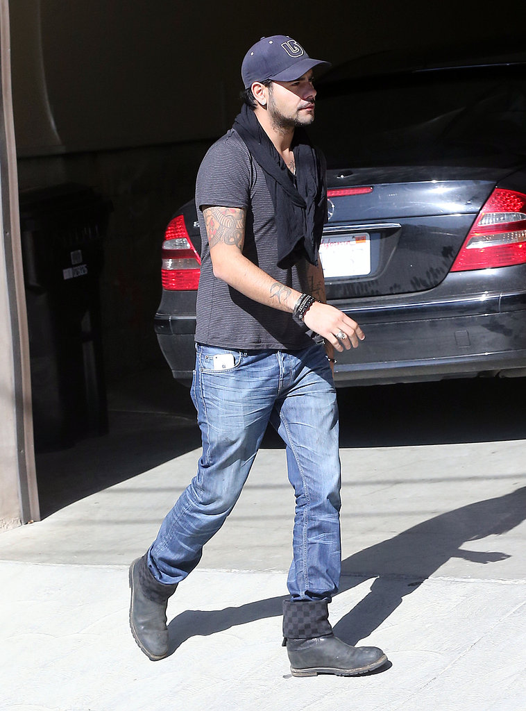 Eduardo Cruz wore a cap while out in LA.